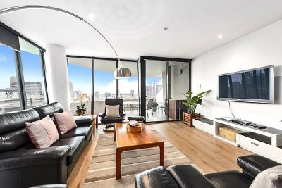 Large lounge and balcony with views of Docklands